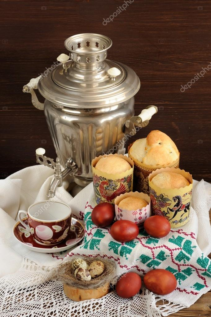 Kulichi, traditional Russian easter cakes with samovar, dyed egg