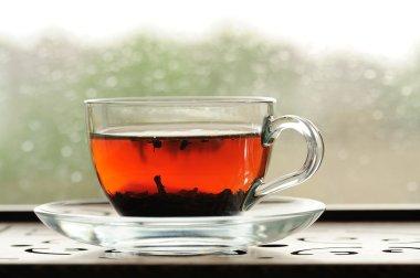 Shu puerh tea brewed in glass cup on window sill