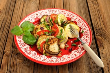 Tasty vegetarian ratatouille made of eggplants, squash, tomatoes