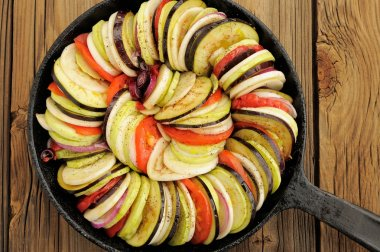 Raw vegetables layed for ratatouille made of eggplants, squash,