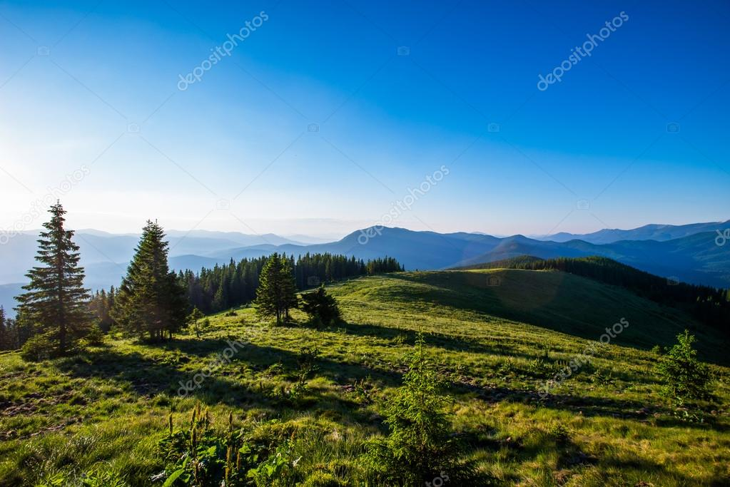 Blue sky and green hills