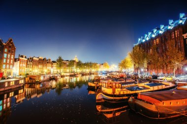 Beautiful night in Amsterdam. Night illumination of buildings an
