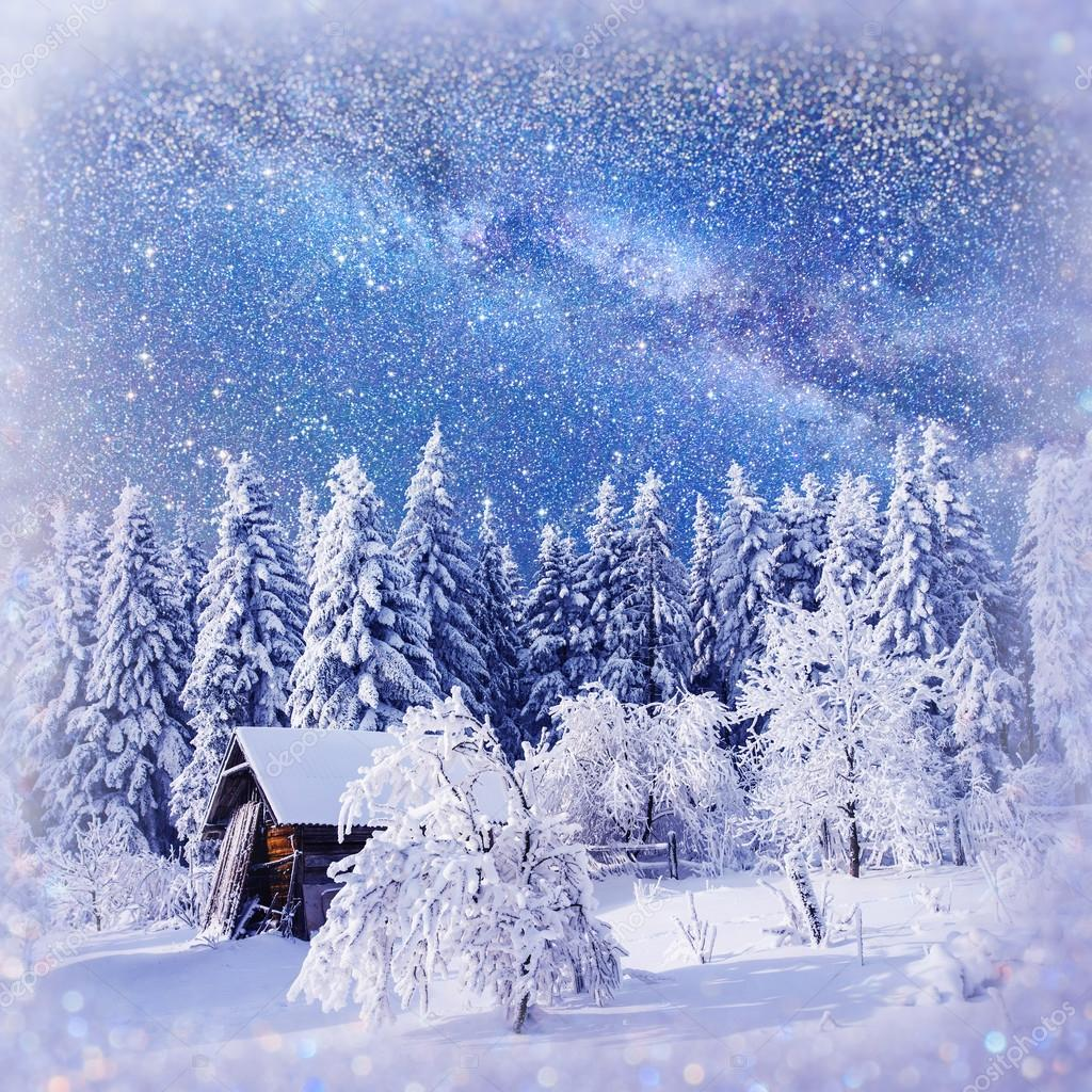 fantastic winter landscape. Chalet under the stars. background w