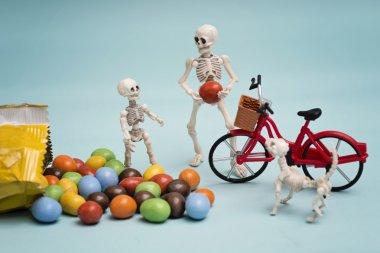 """Картина, постер, плакат, фотообои """"скелеты и шоколадные конфеты """", артикул 118245244"""