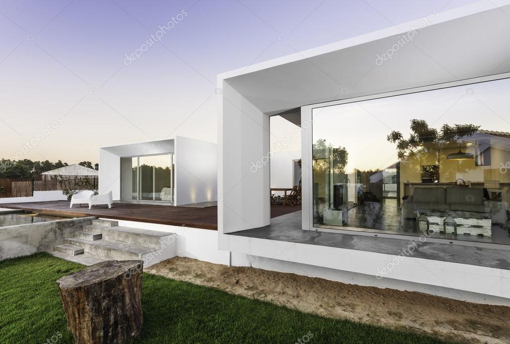Modern House With Garden Swimming Pool And Wooden Deck  Stock - House with garden and swimming pool
