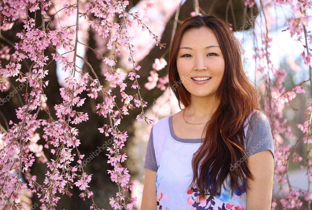 Asian Woman With Cherry Blossom Or Sakura Smiling Happy