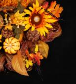 Autumn or Thanksgiving Bouquet over black background. Pumpkin, S