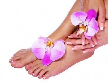 Nail care. French Manicure on Female Feet and Hands