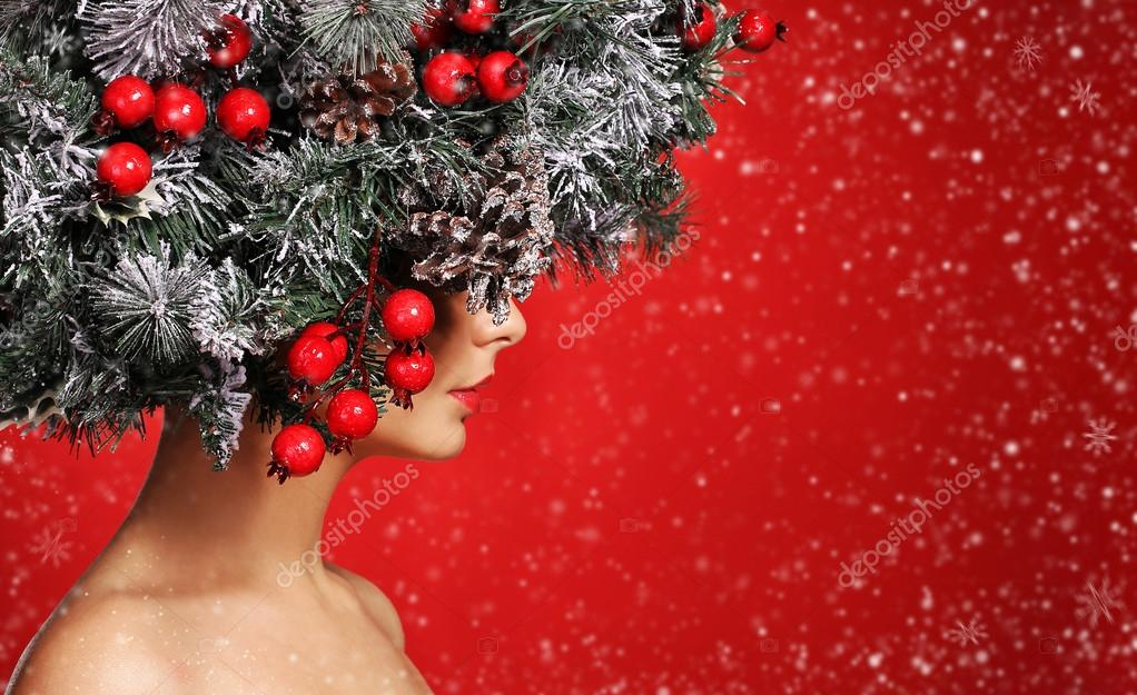 Christmas Woman. Fashion Girl with New Year Decorated Hairstyle.