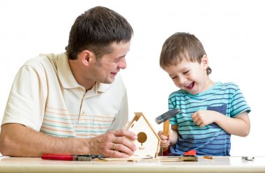 Father and son working with hammer together