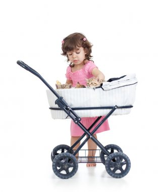 Child with carriage  with   kittens