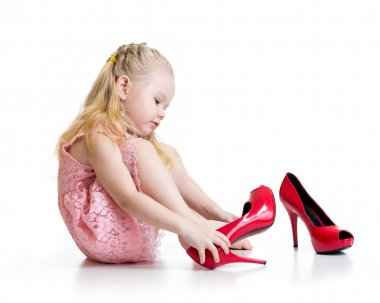 Little girl trying mother shoes