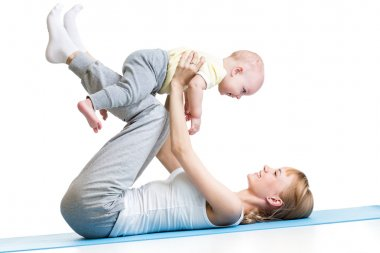 mother and baby making gymnastics
