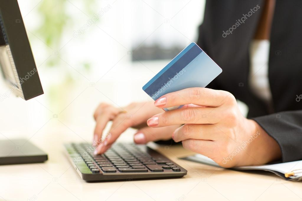 Business woman holding credit card for online payment stock photo business woman holding credit card for online payment fotografia de stock reheart Image collections