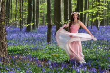 Fairy dance in springtime forest