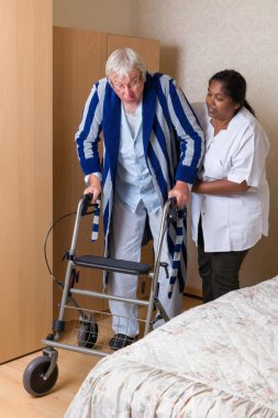 Nurse helping with rollator