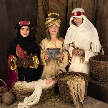 Smiling wisemen in christmas nativity scene