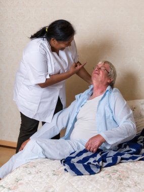 Nurse shouting at elderly man