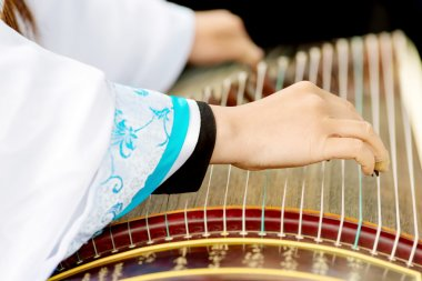 Girl playing classical Chinese instruments