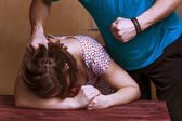 Photo Man beating up his wife