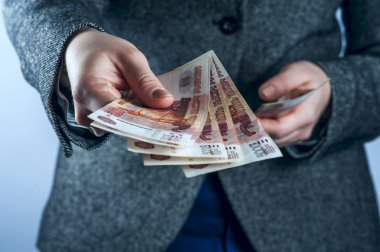 Woman holds Russian rubles.
