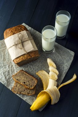 Banana bread slices with glasses of milk