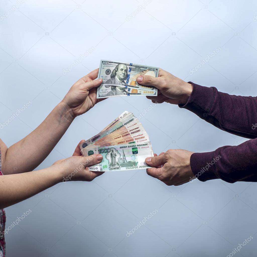 Man and woman exchange money — Stock Photo © by_ShiShkin #96382910