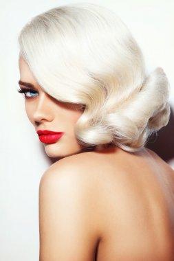 Beautiful woman with vintage hairdo