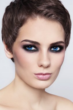 woman with short haircut and smoky eyes