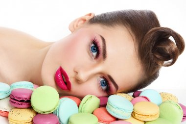 beautiful woman with colorful macaroons