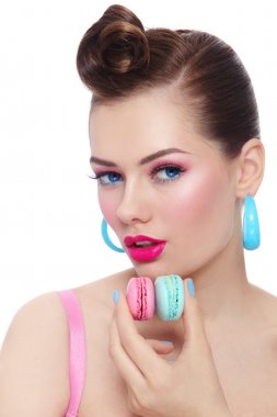 beautiful woman with macaroons