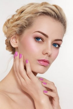blond girl with pink make-up and manicure