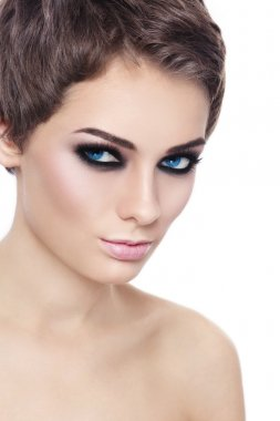 woman with stylish short haircut and smoky eyes