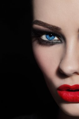 face with red lips and smoky eyes