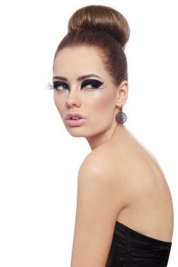 woman with fancy cat eyes make-up