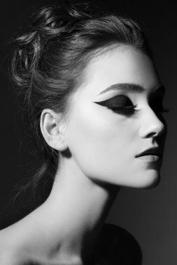 woman with stylish cat eyes makeup