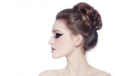 woman with hair bun and cat eyes