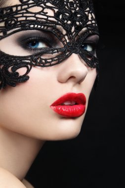 woman in black lacy mask