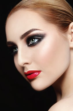 woman with red lips and smoky eyes