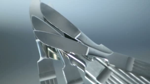 Five Scalpels rotating on mirror