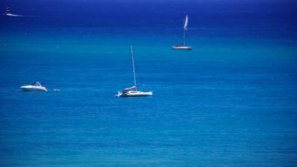 Boats Floating in Ocean