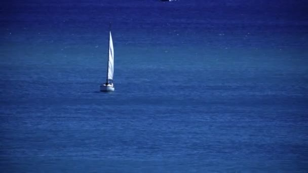 Sailboat in blue ocean