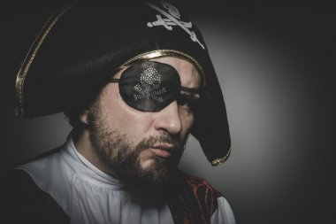 pirate with eye patch posing