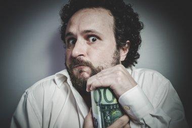 man in white shirt holding money box