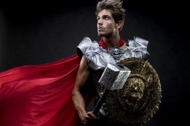 centurion or Roman warrior with iron armor, military helmet with