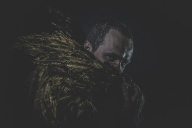 Man with beard and suit made with golden wings