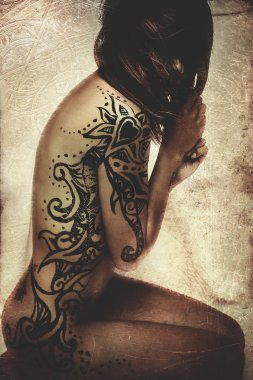 Latin woman with tattoos on the skin