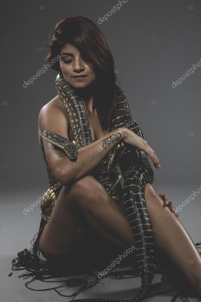 63239594f420 Young brunette woman in bronze metal corset with big snake foto de  outsiderzone jpg 682x1023 Female
