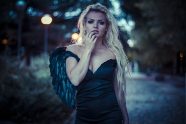 Blonde angel with black wings