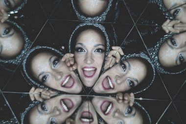 Beautiful brunette woman surrounded by mirrors